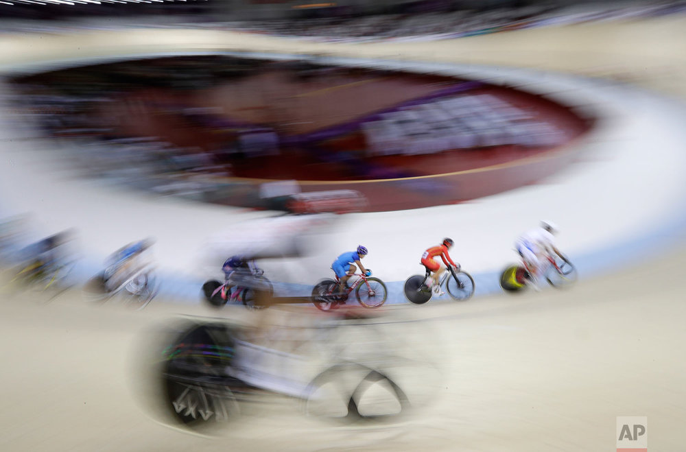 Riders compete in the women's omnium gold medal race during the track cycling at the 18th Asian Games in Jakarta, Indonesia, Wednesday, Aug. 29, 2018. (AP Photo/Aaron Favila)