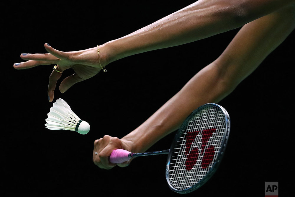 Pusarla V. Sindhu of India serves while competing against Carolina Marin of Spain in their women's badminton championship match at the BWF World Championships in Nanjing, China, Sunday, Aug. 5, 2018. (AP Photo/Mark Schiefelbein)