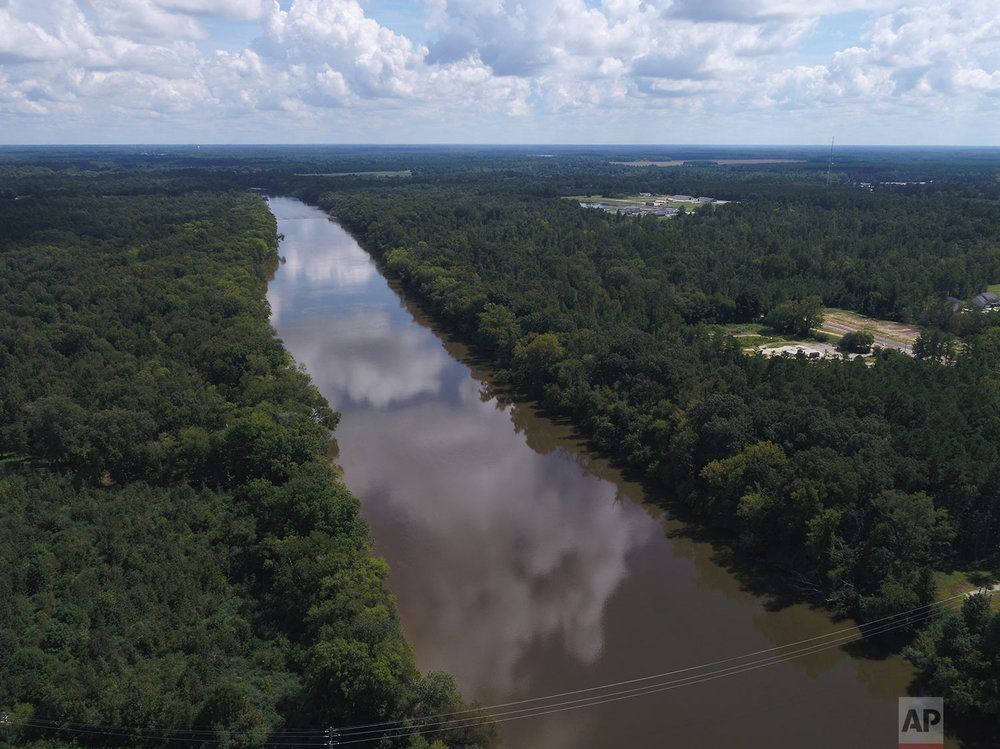 In this Tuesday afternoon, Sept. 12, 2018 photo provided by DroneBase, an aerial view of the Cape Fear River, N.C., in Buckhorn, N.C. is shown ahead of Hurricane Florence. (DroneBase via AP)