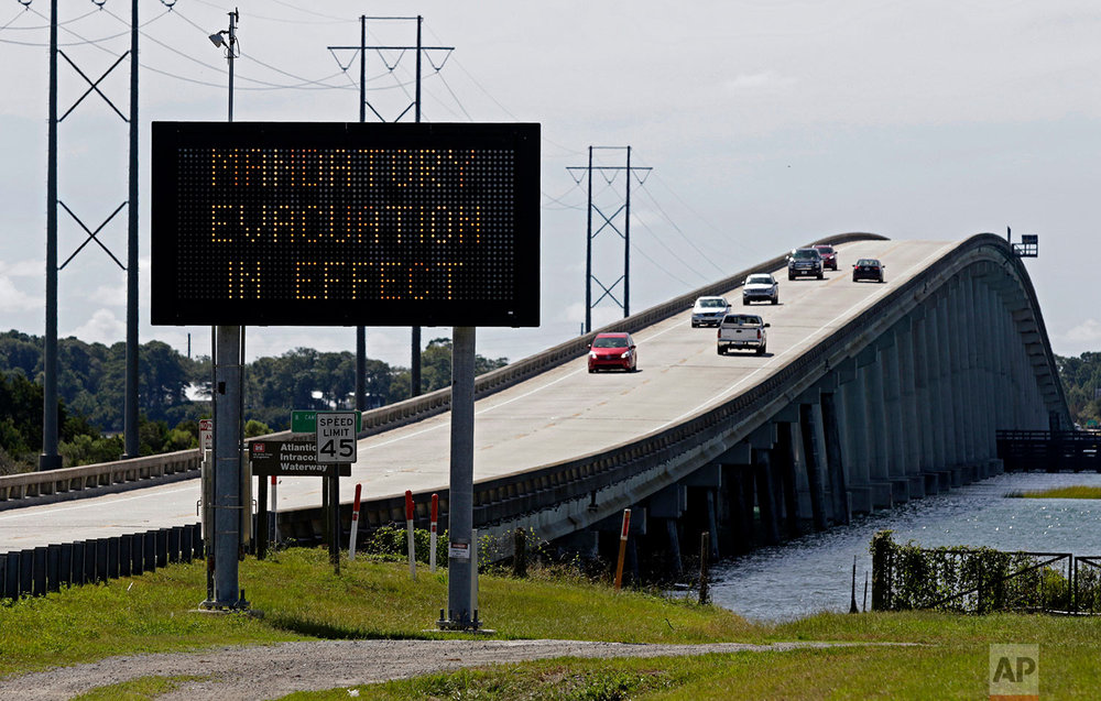 A sign posts a mandatory evacuation prior to Hurricane Florence in Emerald Isle N.C., Wednesday, Sept. 12, 2018. (AP Photo/Tom Copeland)