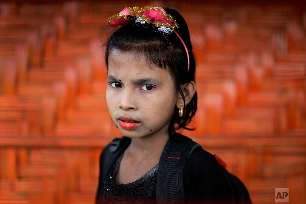 Ranjeda, 9, poses for a portrait in front of her classroom on June 27, 2018, in Chakmarkul refugee camp, Bangladesh. (AP Photo/Wong Maye-E)