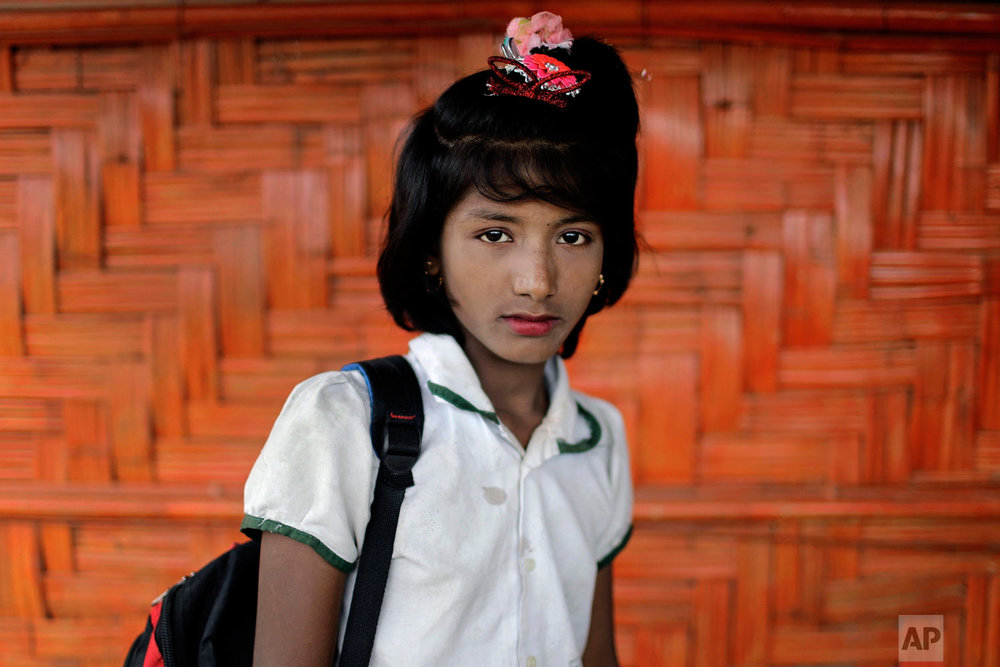 Dil Kayas, 12, poses for a portrait in front of her classroom on June 27, 2018, in Chakmarkul refugee camp, Bangladesh. (AP Photo/Wong Maye-E)