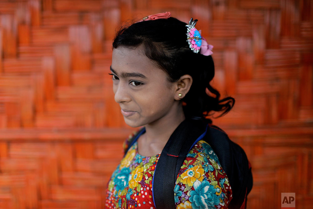 Wisma Bi Bi, 12, poses for a portrait in front of her classroom on June 27, 2018, in Chakmarkul refugee camp, Bangladesh. (AP Photo/Wong Maye-E)