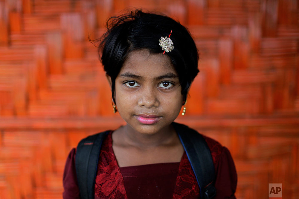Nazifa, 10, poses for a portrait in front of her classroom on June 27, 2018, in Chakmarkul refugee camp, Bangladesh. (AP Photo/Wong Maye-E)