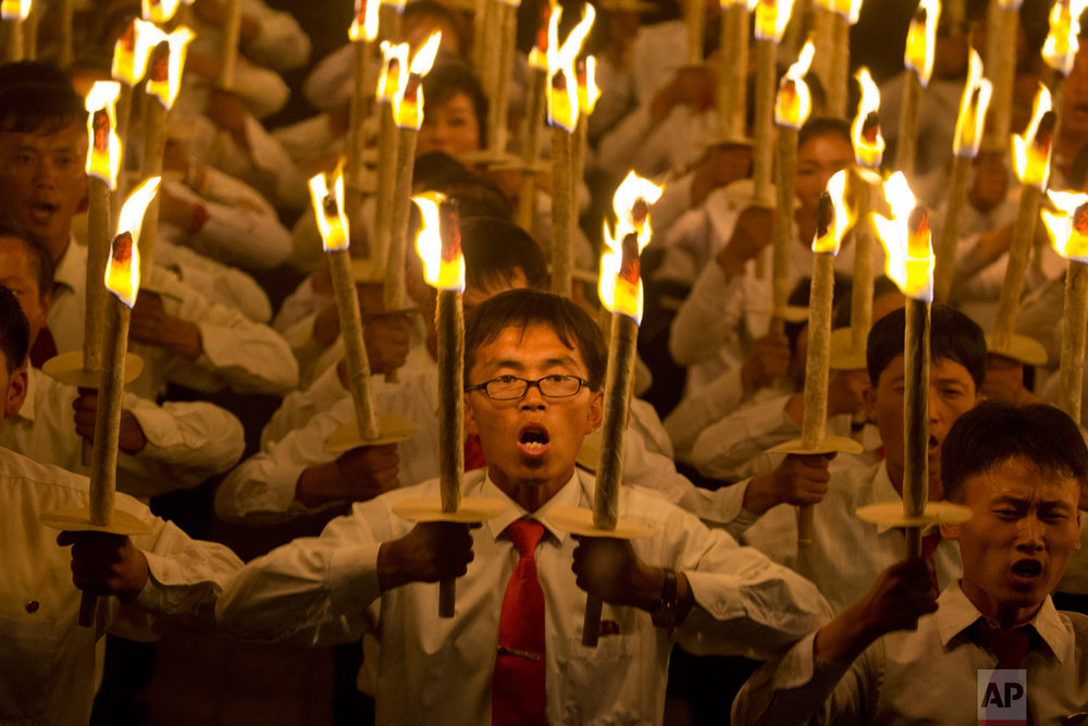 North Korean students take part in a torch light march held in conjunction with the 70th anniversary of North Korea's founding day celebrations in Pyongyang, North Korea, Monday, Sept. 10, 2018. (AP Photo/Ng Han Guan)