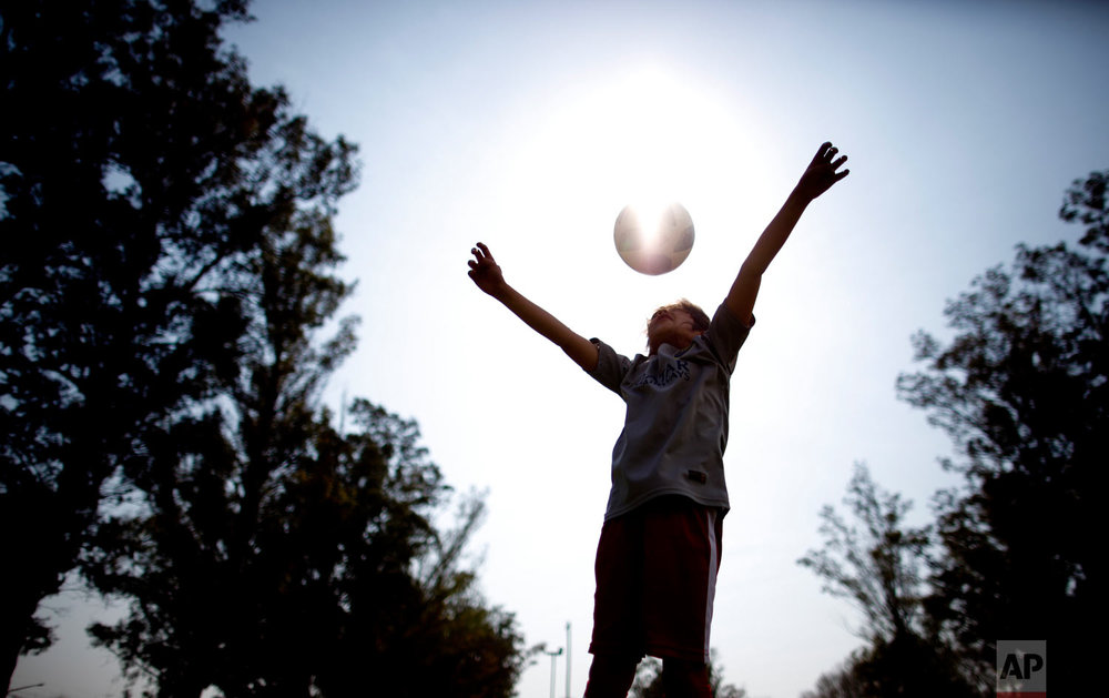 "Candelaria Cabrera plays with a soccer ball in Chabas, Argentina on Saturday, Sept. 8, 2018. ""Cande,"" as she is known by friends and family, is the only girl playing in a children's soccer league in the southern part of Argentina's Santa Fe province, birthplace of stars including Lionel Messi, Gabriel Batistuta and Jorge Valdano. (AP Photo/Natacha Pisarenko)"