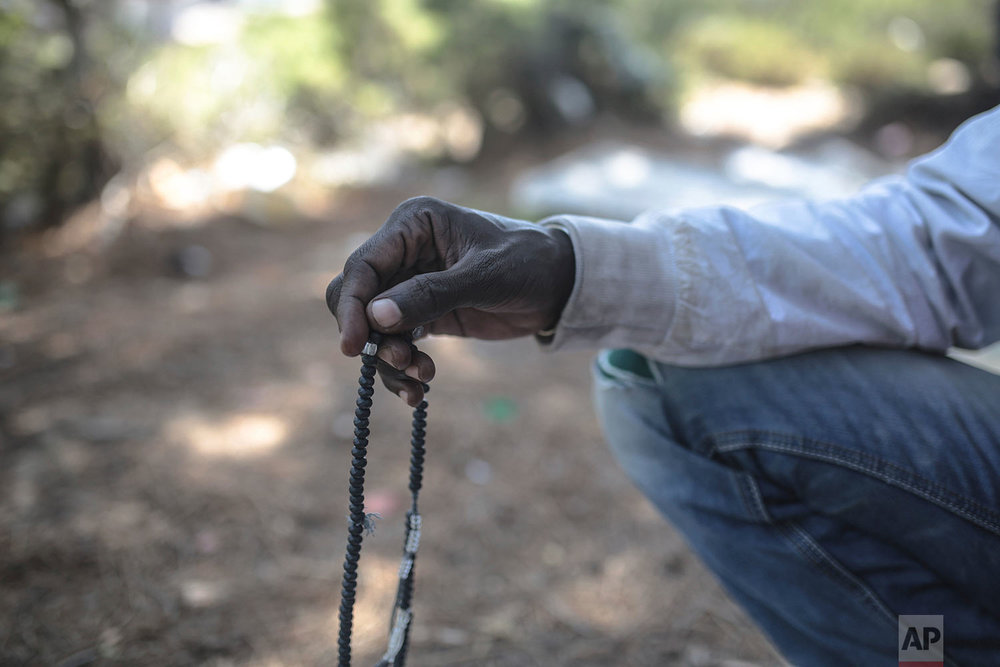A Muslim sub-Saharan migrant aiming to cross to Europe performs prayers as he takes shelter in a forest near Masnana, Sept. 5, 2018, on the outskirts of Tangier, Morocco. (AP Photo/Mosa'ab Elshamy)