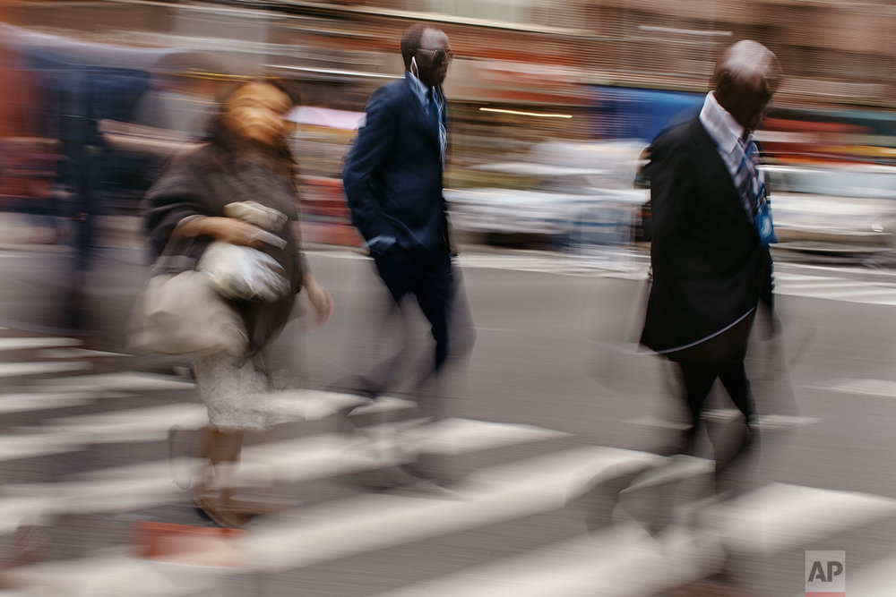 People walk towards the U.N. headquarters on Friday, Sept. 28, 2018, in New York. At the U.N. General Assembly this year, leader after leader mused about the challenges of an increasingly fragmented planet and how the friction of modern life can mesh with old suspicions that can now be amplified in an instant. In short: Most of us humans are led by people struggling to figure out the same dizzying world that vexes the rest of us. (AP Photo/Andres Kudacki)