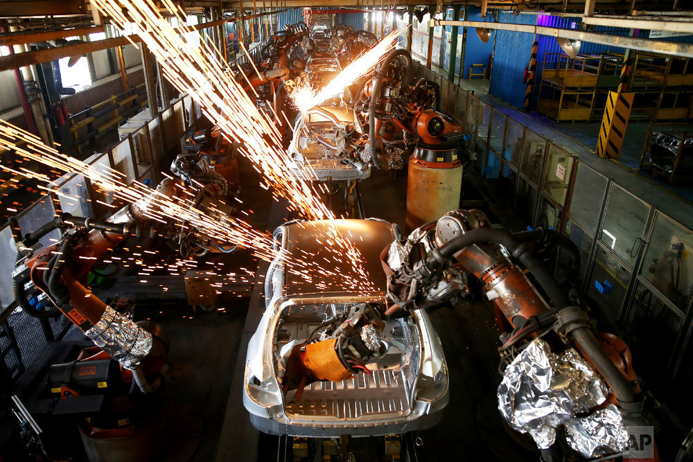 Bodies of cars go through an assembly line at the Iran Khodro automobile manufacturing plant, just outside Tehran, Iran on Sept. 9, 2018. As Iran's rial currency suffers precipitous falls against the U.S. dollar, cars are growing more and more expensive. Meanwhile, foreign manufacturers are pulling out from the country and foreign-produced parts are becoming harder to find. (AP Photo/Ebrahim Noroozi)