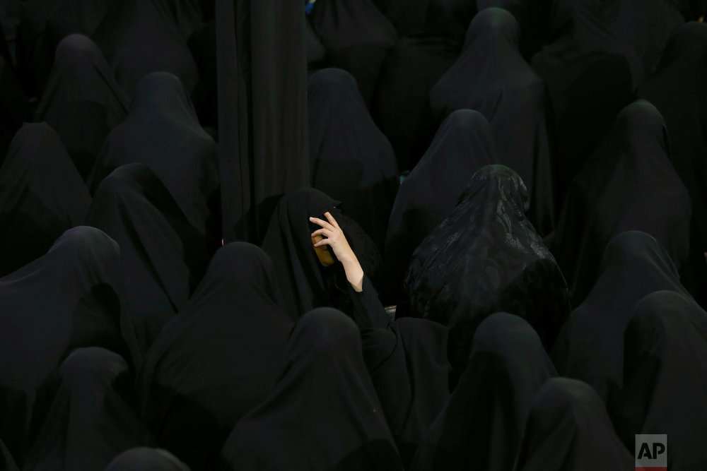 Muslim Shiite women mourn during the holy day of Ashoura, at the Sadat Akhavi Mosque in Tehran, Iran, Sept 20, 2018. (AP Photo/Ebrahim Noroozi)