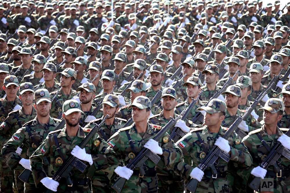 Iranian armed forces members march in a military parade marking the 38th anniversary of Iraq's 1980 invasion of Iran, in front of the shrine of the late revolutionary founder, Ayatollah Khomeini, just outside Tehran, Iran, Sept. 22, 2018. (AP Photo/Ebrahim Noroozi)