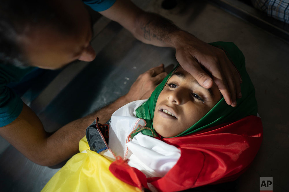 A relative mourns over the body of 11-year old Shady Abdel-al during his funeral in Beit Lahiya, northern Gaza Strip, Sept. 15, 2018. (AP Photo/Felipe Dana)