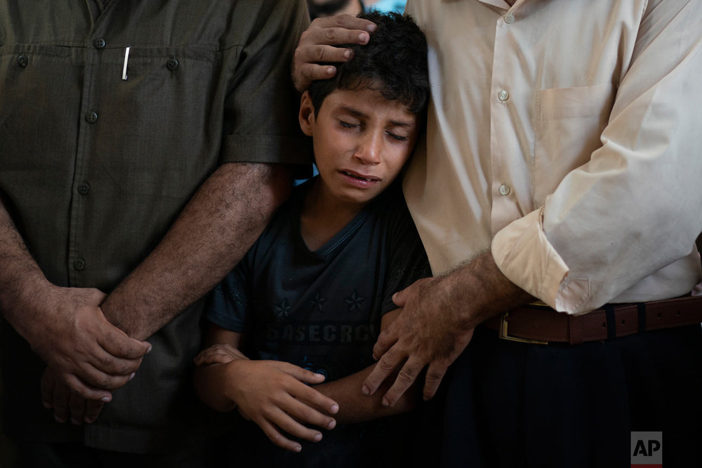 Mahmoud Abdel-al, 11, cries during the funeral of his twin brother Shady Abdel-al in Beit Lahiya, Gaza Strip, Sept. 15, 2018. (AP Photo/Felipe Dana)