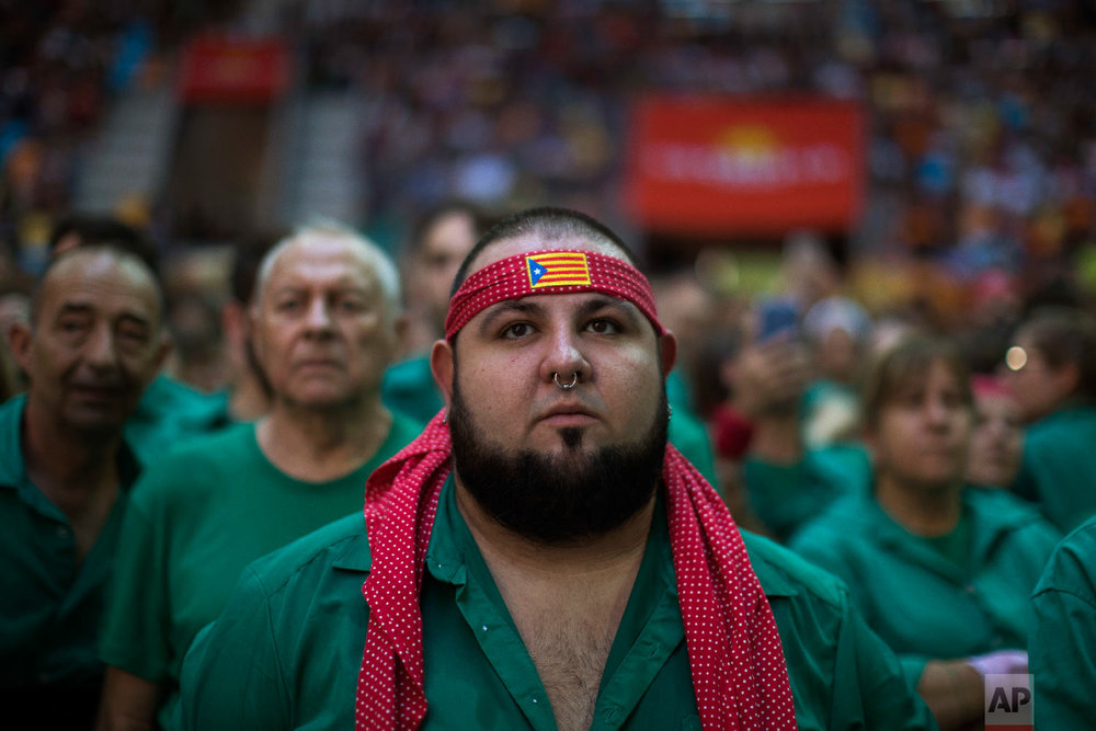 Arnau Cornado, 24, looks as members of the Castellers de Terrassa try to complete their human tower, during the 27th Human Tower Competition in Tarragona, Spain on Oct. 6, 2018. (AP Photo/Emilio Morenatti)