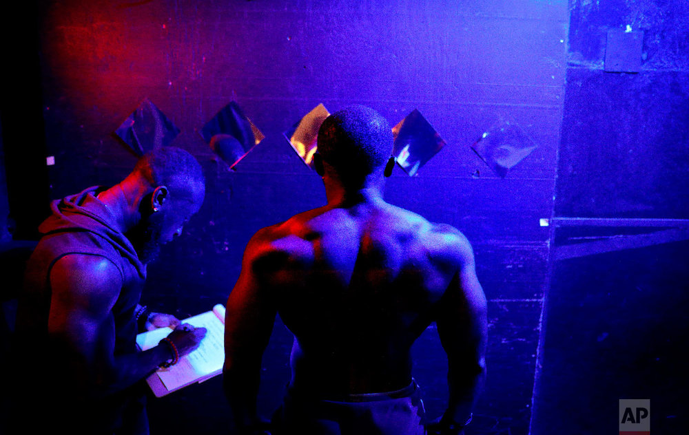 Wes Phills, of Brooklyn, N.Y., is weighed in before the start of the International Association of Trans Bodybuilders competition in Atlanta, Oct. 6, 2018. (AP Photo/David Goldman)