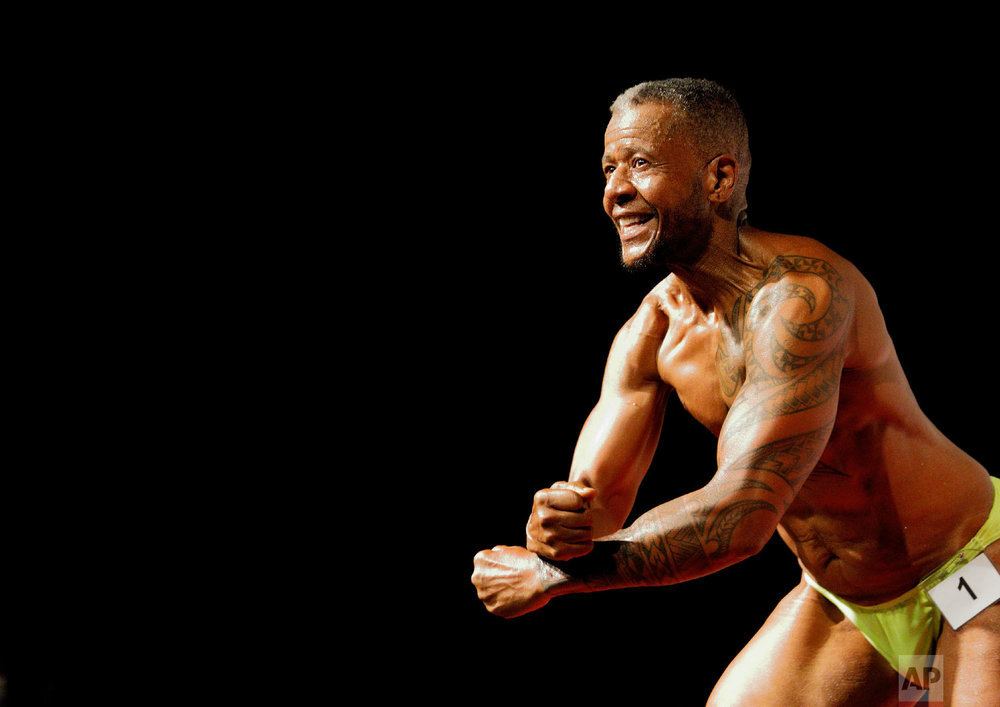 Charles Bennett, of San Francisco, performs at the International Association of Trans Bodybuilders competition in Atlanta, Oct. 6, 2018. (AP Photo/David Goldman)