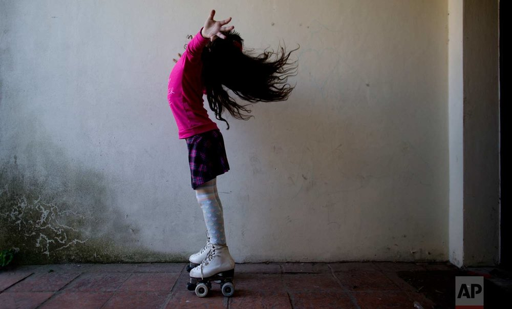 "In this Sept. 29, 2015, photo, Luana poses for photos on her roller skates at her home in Merlo, Argentina. Luana says that when one of the girls asked her why she had a penis, a friend jumped in. ""She's transsexual,"" the child explained, nonchalantly. That level of comfort is no doubt in part because Luana herself appears so at ease. In 2013, she became the youngest person to take advantage of a progressive Argentine law that allows people to identify their own gender for legal purposes. (AP Photo/Natacha Pisarenko)"