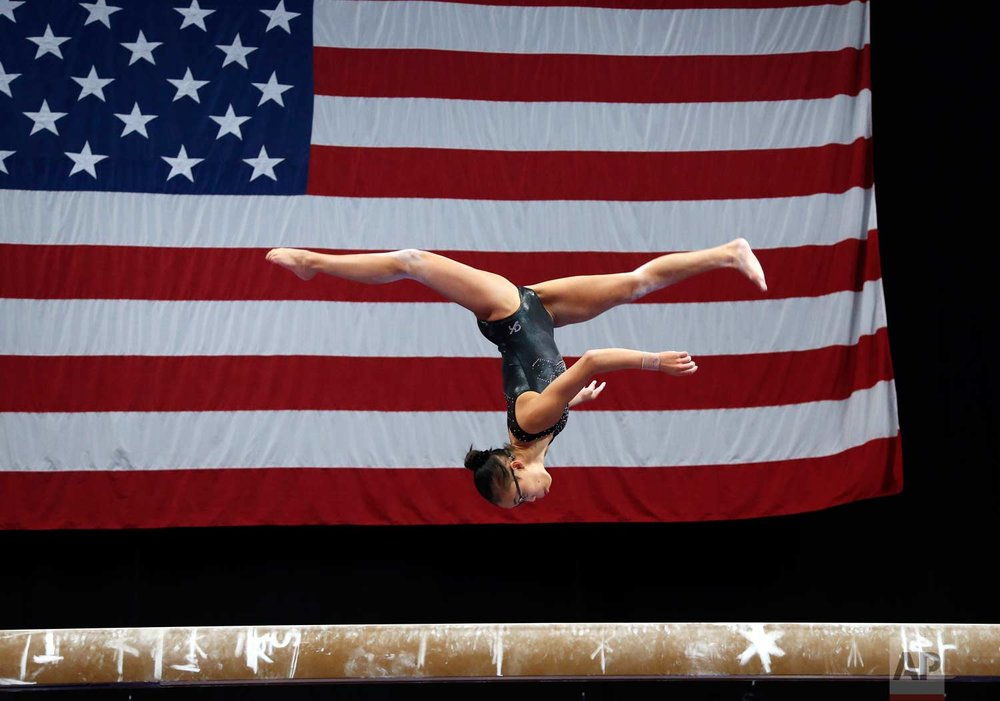 In this Aug. 15, 2018, photo, Morgan Hurd practices on the balance beam during a training session at the U.S. Gymnastics Championship. (AP Photo/Elise Amendola)