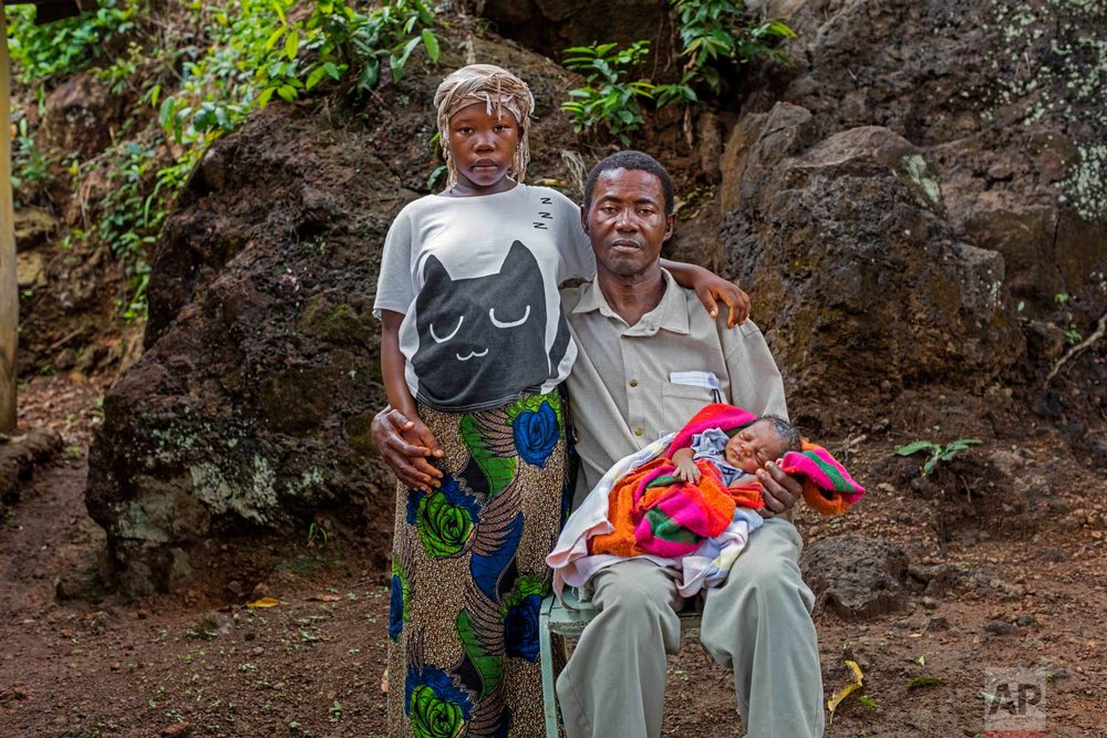 In this photo taken in 2016, Baby Seibureh, 17, and Claude Seibureh, 48, of Freetown, were married during the Ebola crisis. Because of her small stature, Baby needed a cesarean section to safely give birth to their son, Joseph. While child marriage is a critical issue in both crisis and stable contexts, child marriage is rising at alarming rates in humanitarian settings. (Stephanie Sinclair/Too Young to Wed via AP)