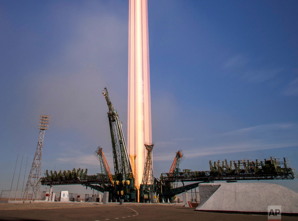 In this photo made with a long exposure, the Soyuz MS-10 spacecraft launches with U.S. astronaut Nick Hague and cosmonaut Alexey Ovchinin at the Baikonur Cosmodrome in Kazakhstan on Thursday, Oct. 11, 2018. Two minutes after setting off for the International Space Station, their rocket failed, triggering an emergency landing. The crew returned safely. (Bill Ingalls/NASA via AP)