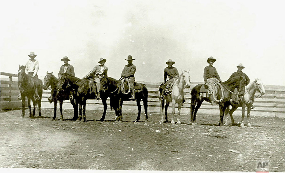 This around 1910 photo provided by Francine Locke Bray shows Victor M. Locke, Sr., center, with unknown cowboys on Choctaw horses in Pushmataha County, Okla. (Francine Locke Bray via AP)
