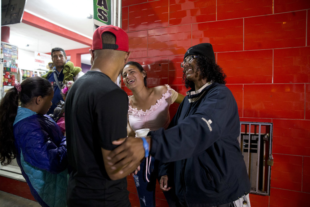 Sandra Cadiz and her daughter reunite with Cadiz's son Leonardo and her daughter-in-law on Sept. 8, 2018. (AP Photo/Ariana Cubillos)