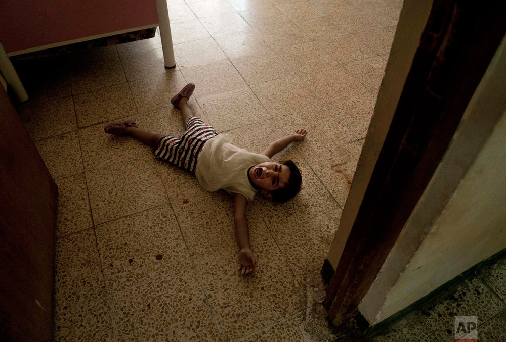 A girl has a tantrum at the state-run al-Zuhour Orphanage in Mosul, Iraq. (AP Photo/Maya Alleruzzo)