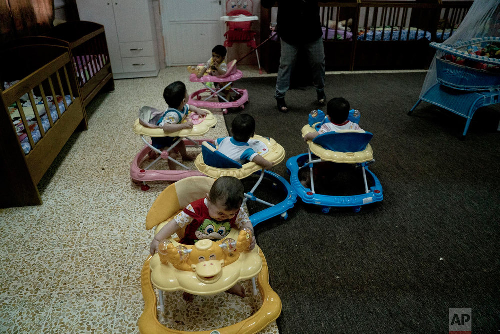 Babies toddle around in walkers at the state-run al-Zuhour Orphanage in Mosul, Iraq. (AP Photo/Maya Alleruzzo)