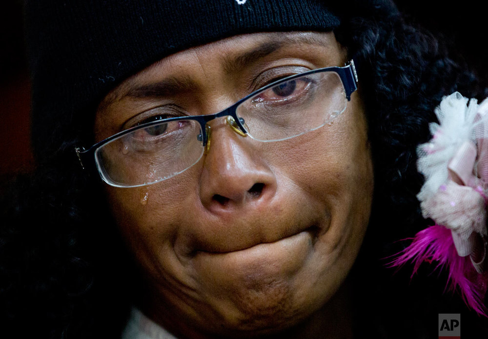 In this Sept 8, 2018 photo, Sandra Cadiz cries as she reunites with her son's family at the bus station in Lima, Peru, at the end of her long trip from Venezuela. When Cadiz' son Leonardo, his wife and their daughter walked up to the bus station they wrapped their newly arrived family members in an embrace, gathered their bags and began the final walk home. (AP Photo/Ariana Cubillos)