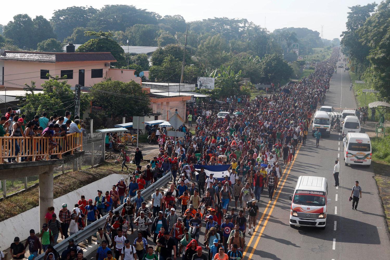 Caravan of migrants grows ahead of push into Mexico