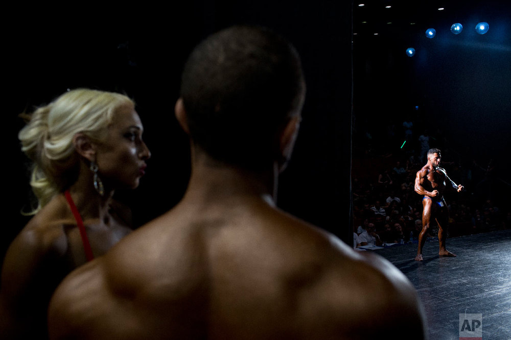 A contestant flexes for the judges during the National Amateur Body Builders' Association competition in Tel Aviv, Israel on Oct. 18, 2018. (AP Photo/Oded Balilty)