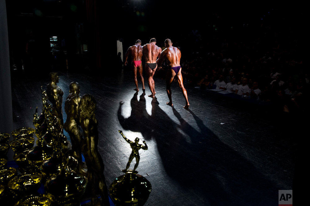 Contestants participate in the National Amateur Body Builders' Association competition in Tel Aviv, Israel on Oct. 18, 2018. (AP Photo/Oded Balilty)
