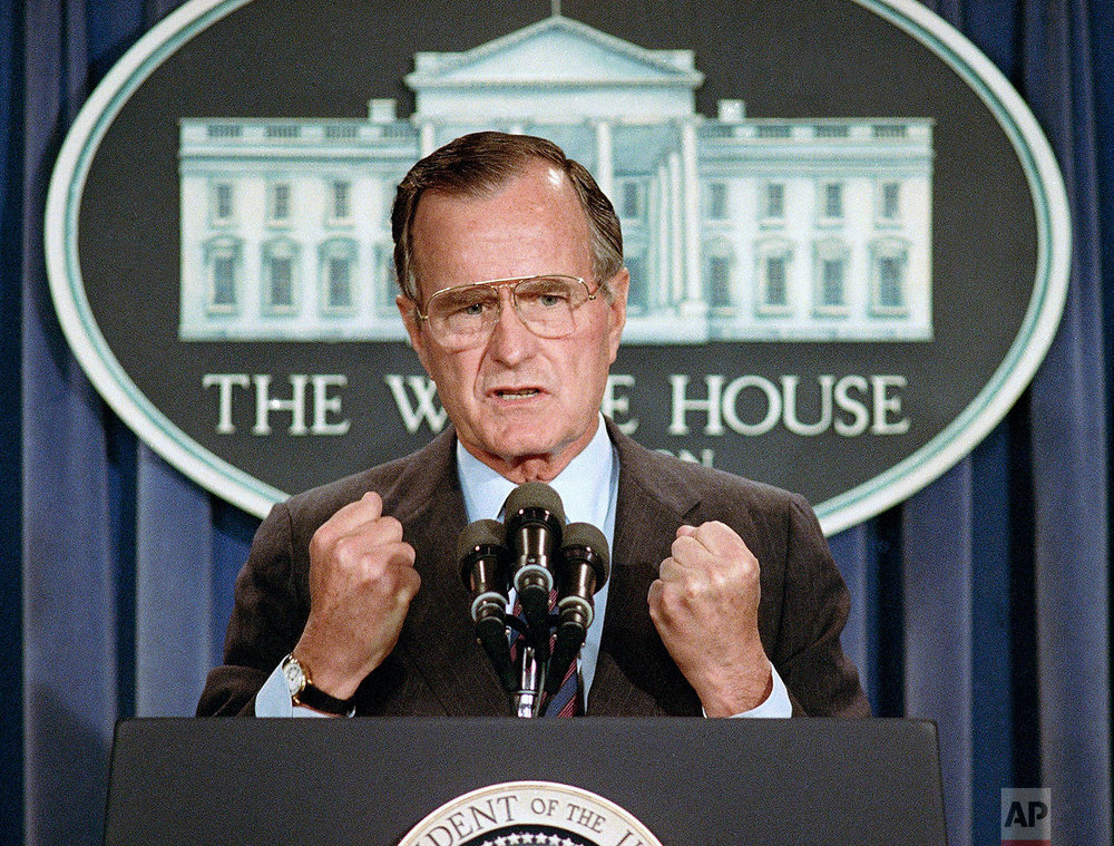 U.S. President George H. Bush holds a news conference at the White House, Monday, June 5, 1989 in Washington where he condemned the Chinese crackdown on pro-democracy demonstrators in Beijing's Tiananmen Square. (AP Photo/Marcy Nighswander)