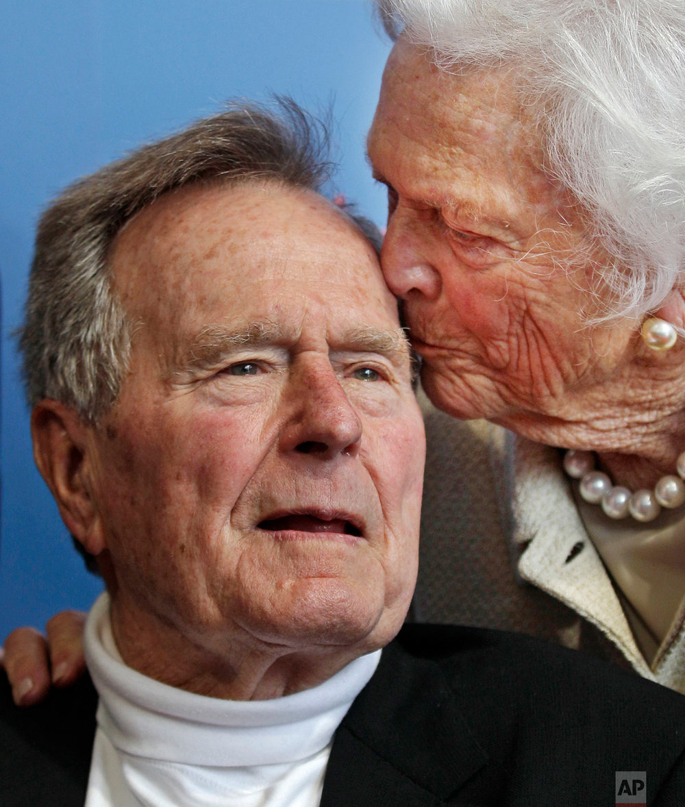 Former President George H.W. Bush, and his wife former first lady Barbara Bush, arrive for the premiere of HBO's new documentary on his life near the family compound in Kennebunkport, Maine, Tuesday, June 12, 2012. (AP Photo/Charles Krupa)