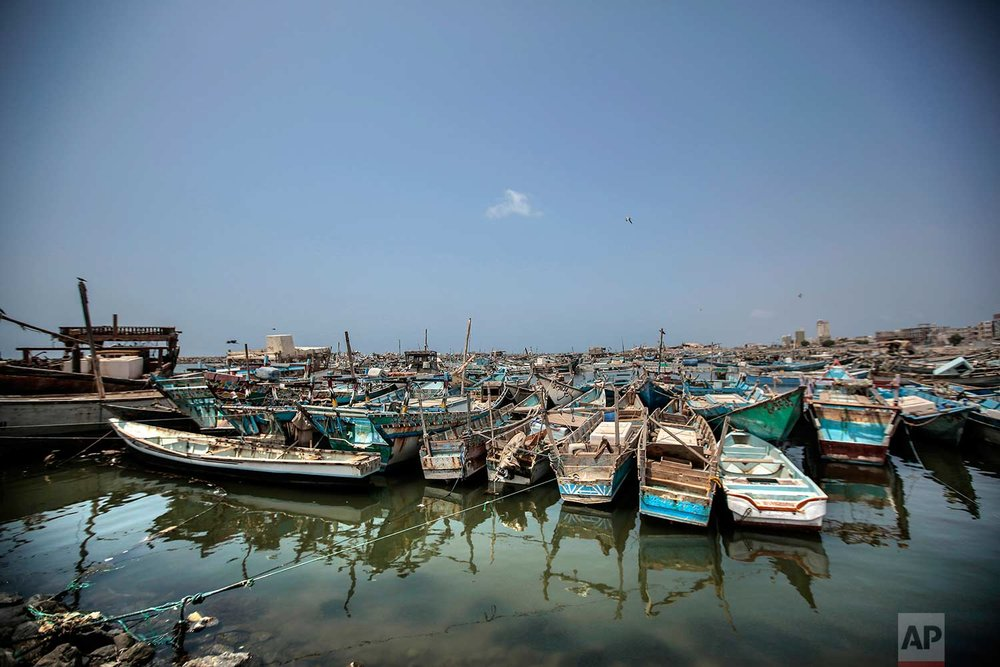 This Sept. 29, 2018, photo, shows fishing boats docked at the main fishing port, in Hodeida, Yemen. (AP Photo/Hani Mohammed)