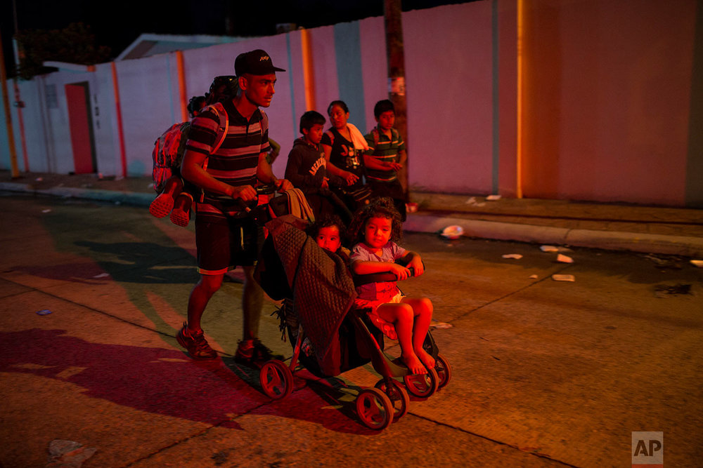Central American migrants traveling with a caravan to the U.S., prepare to leave Mapastepec, Mexico, Thursday, Oct. 25, 2018. (AP Photo/Rodrigo Abd)