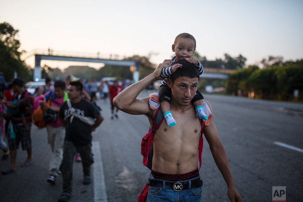 Central American migrants traveling with a caravan to the U.S. in make their way to Mapastepec, Mexico, Wednesday, Oct. 24, 2018. (AP Photo/Rodrigo Abd)