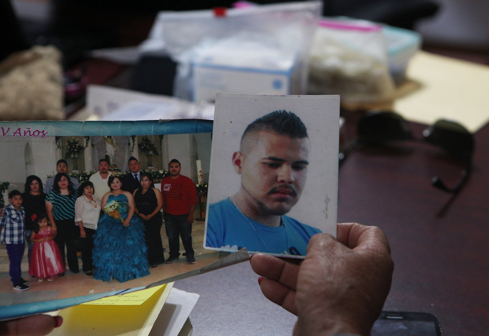 In this Thursday, March 22, 2018 photo, a photo of Armando Reyes, who disappeared in 2016, is displayed at a human rights commission in Chihuahua, Mexico. (AP Photo/Marco Ugarte)