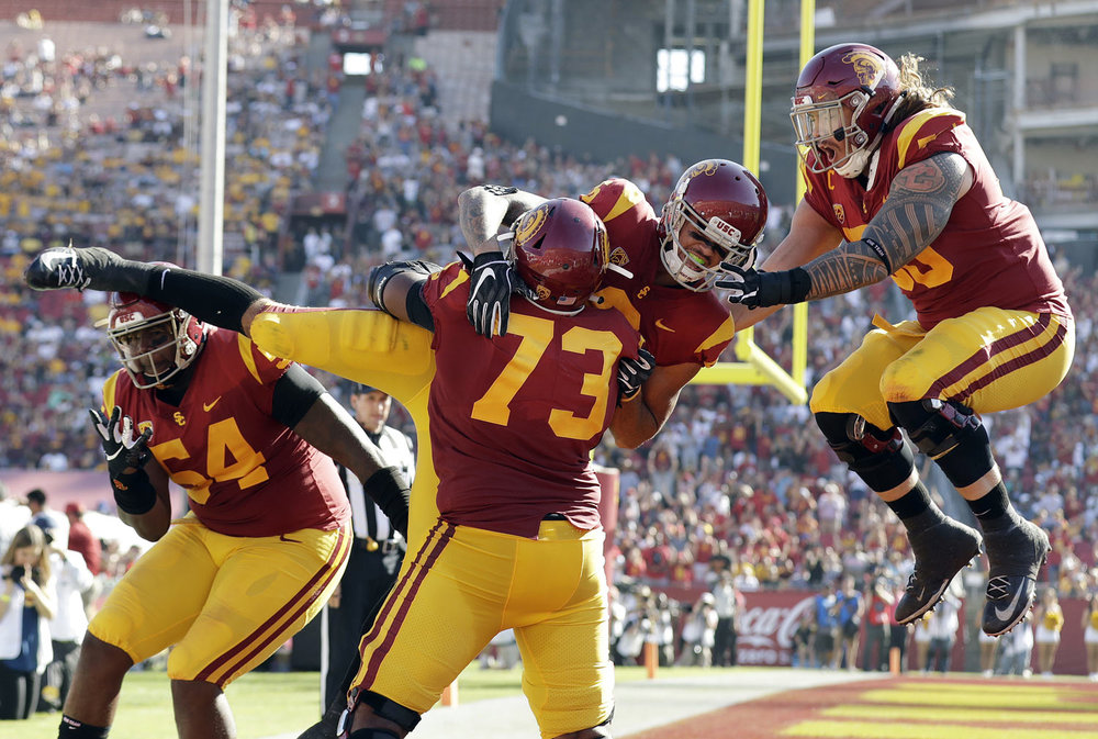 Southern California wide receiver Michael Pittman Jr., center right, is lifted by teammate Austin Jackson (73) after making a touchdown catch against Arizona State during the second half of an NCAA college football game Saturday, Oct. 27, 2018, in Los Angeles. (AP Photo/Marcio Jose Sanchez)