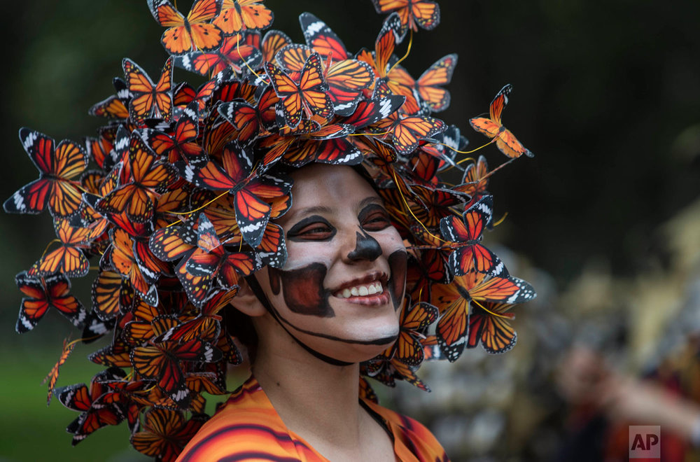 A performer wearing a Monarch butterfly costume attends the Day of the Dead parade in Mexico City Oct. 27, 2018. (AP Photo/Christian Palma)