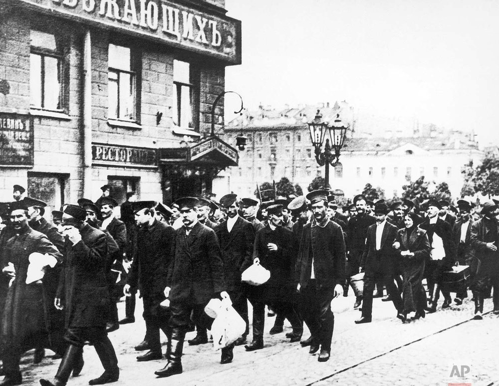 In this Aug. 8, 1914 photo, Russian reservists walk with their belongings in St. Petersburg, Russia. Russia entered World War One with an army which was massive but badly armed. (AP Photo)