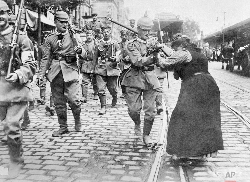In this undated photo, Prussian soldiers leaving Berlin for the front are given flowers by a woman during World War One. (AP Photo)