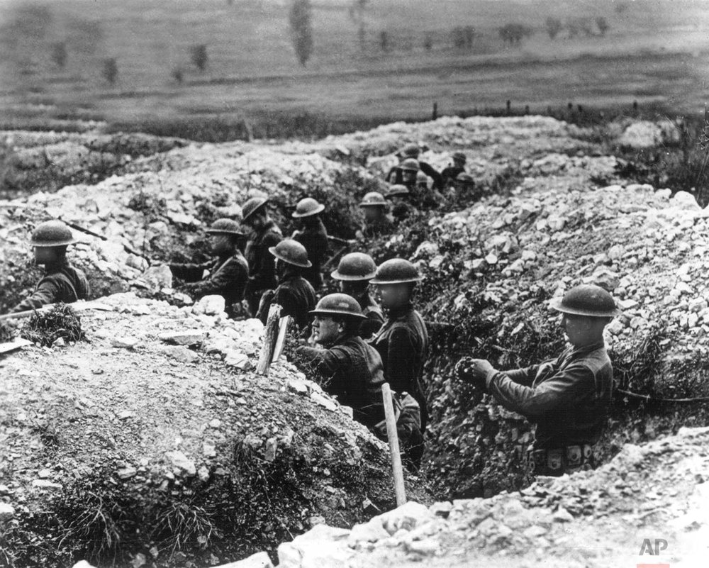 In this undated photo, United States Army troops stand in the trenches in France during World War One. (AP Photo)