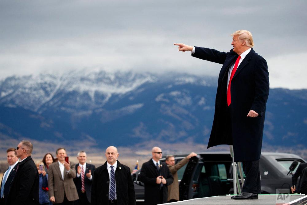 President Donald Trump arrives for a campaign rally at Bozeman Yellowstone International Airport, Saturday, Nov. 3, 2018, in Belgrade, Mont. (AP Photo/Evan Vucci)