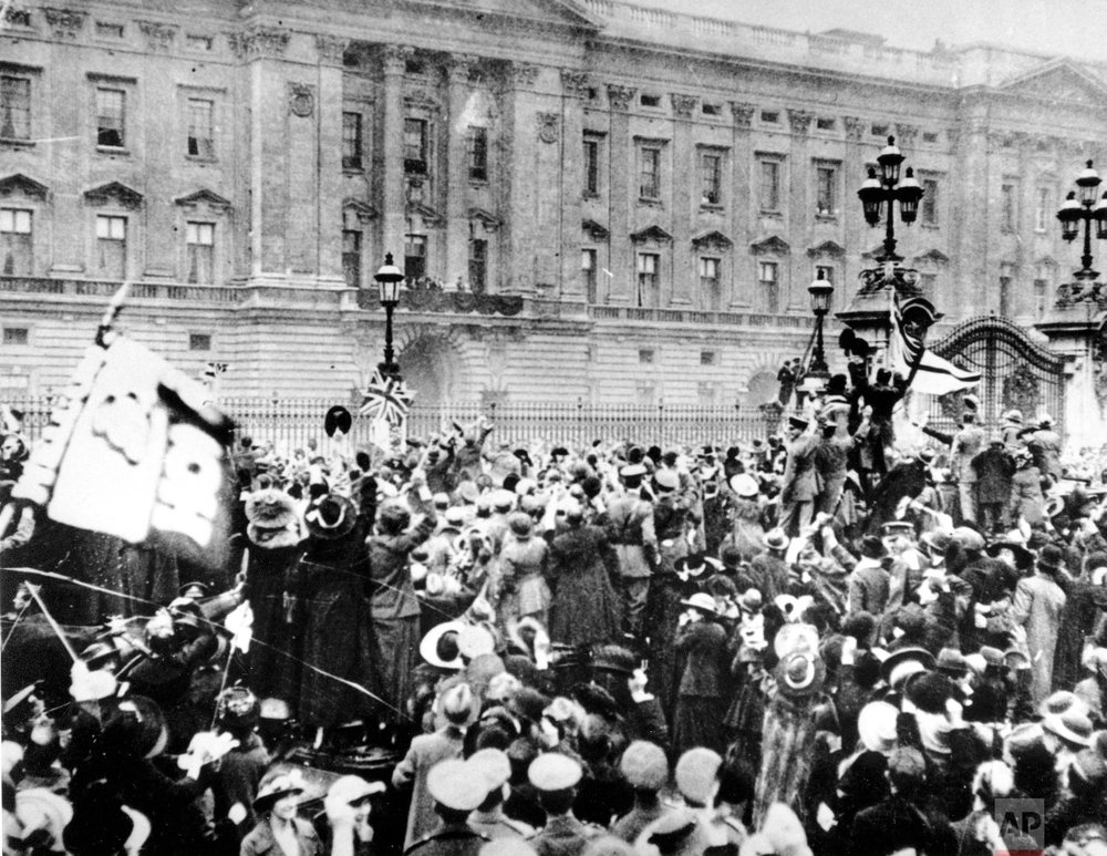 A group of people gather in London to celebrate the signing of the armistice on Nov. 11, 1918 (AP Photo)