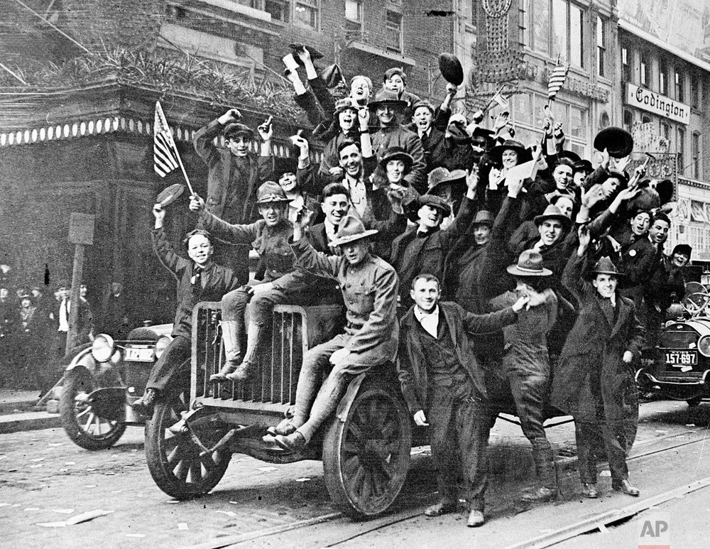 Celebrants cheer along Broadway near New York's Times Square as news of the armistice spreads on Nov. 11, 1918. (AP Photo)