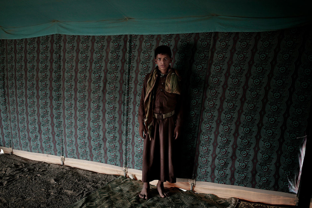 In this July 27, 2018 photo, 15 year-old Nawaf Mohammed, poses for a photograph at a camp for displaced persons where he took shelter with his family, in Marib, Yemen, (AP Photo/Nariman El-Mofty)