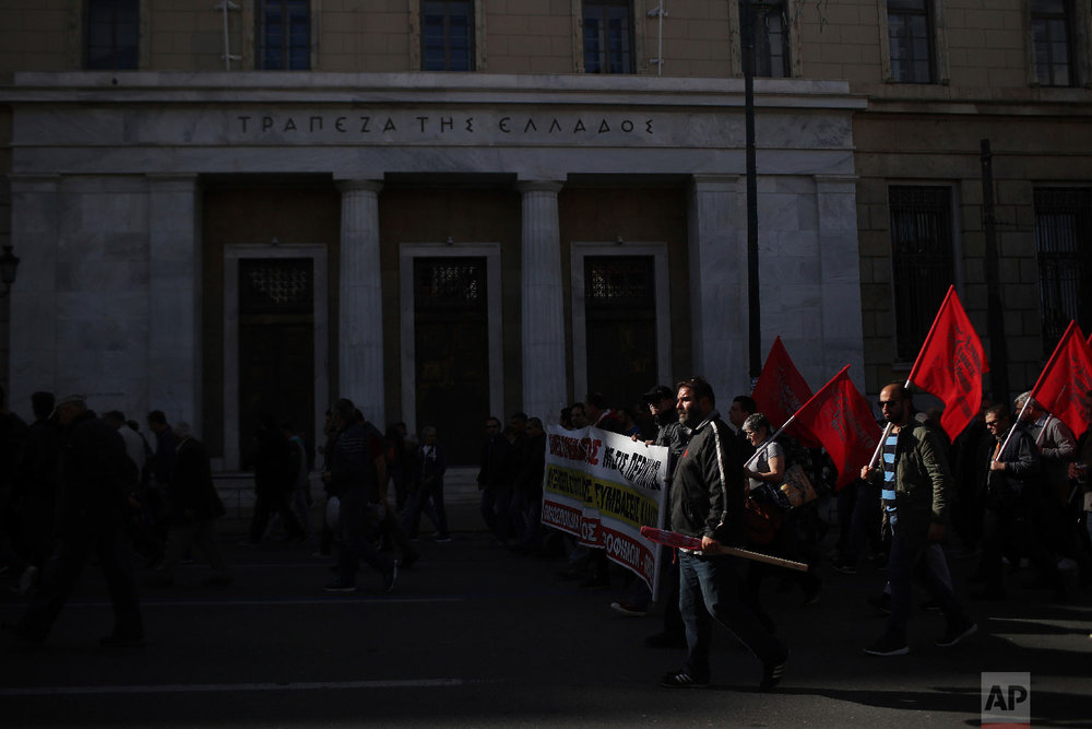 Protesters of a labor union take part in a rally during a 24-hour strike in Athens, Wednesday, Nov. 28, 2018.  (AP Photo/Petros Giannakouris)