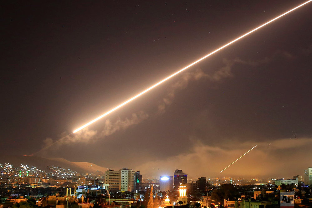 Surface to air missile fire lights up the sky over Damascus at the U.S. launches an attack on Syria early on April 14, 2018. U.S. President Donald Trump ordered the airstrikes in retaliation for Syria's alleged use of chemical weapons. (AP Photo/Hassan Ammar)