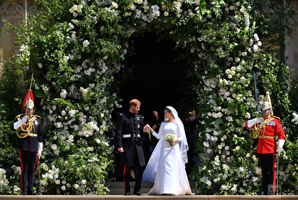 Prince Harry and Meghan Markle leave St. George's Chapel in Windsor Castle after their wedding ceremony in Windsor, England, near London, on May 19, 2018. (Ben Birchhall/pool photo via AP)